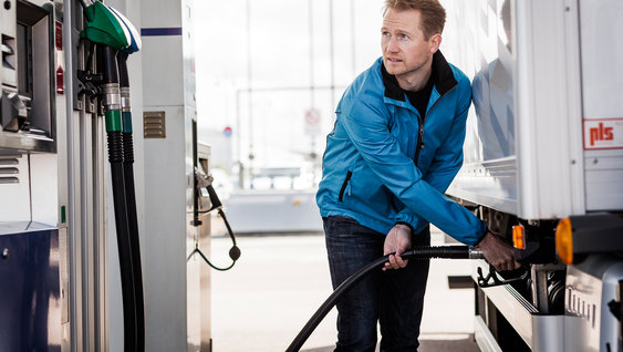 Volvo trucks managing fuel advice man gas station